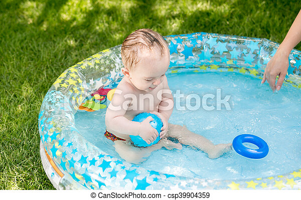 9 months old baby boy playing royalty free stock for Baby garden pool