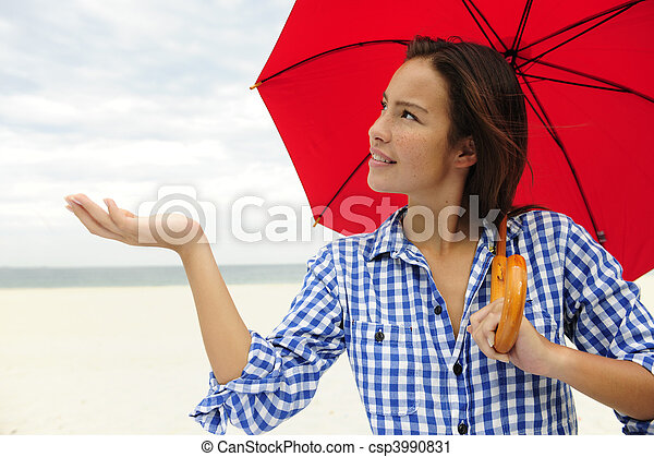 woman with red umbrella touching the rain - csp3990831