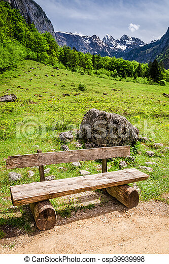 The wooden bench at the Konigssee lake, Alps, Germany - csp39939998
