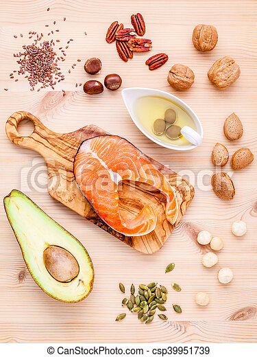 Selection food sources of omega 3 and unsaturated fats. Super food high omega 3 and unsaturated fats for healthy food. Almond ,pecan ,hazelnuts,walnuts ,olive oil ,fish oil ,salmon and avocado .