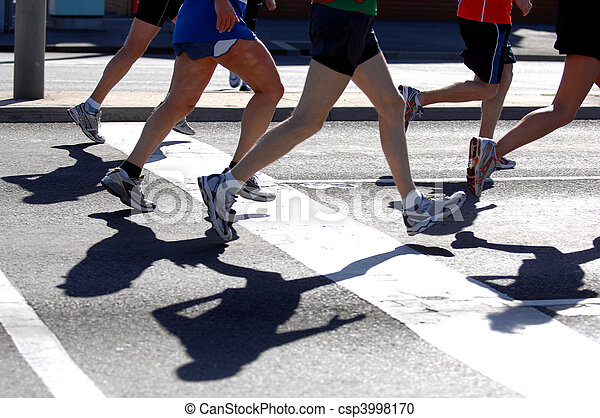 Groups of marathon runner in action - csp3998170