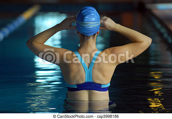 A young woman gets ready for an early morning swim