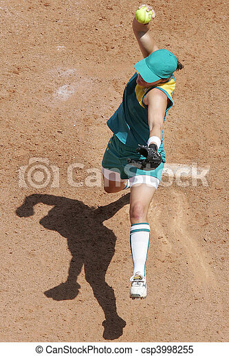 An aerial view of a female softball pitcher in action during a game. - csp3998255