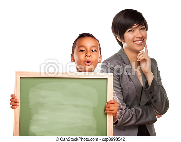Hispanic Boy Holding Chalk Board and Female Teacher Behind - csp3998542