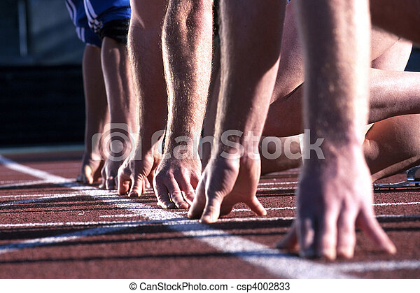 The start line up of runners hands at an athletics race. - csp4002833