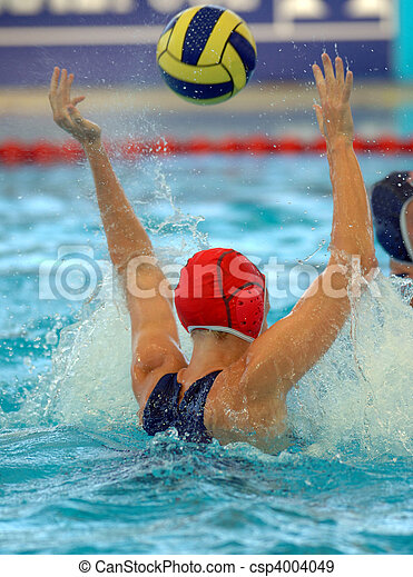 A female water polo goalie misses a shot - csp4004049