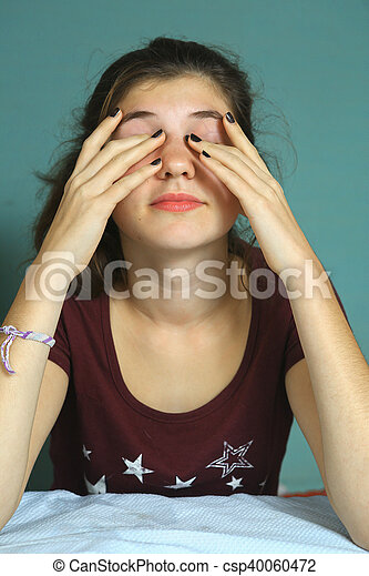 teen girl with tired eyes close up portrait