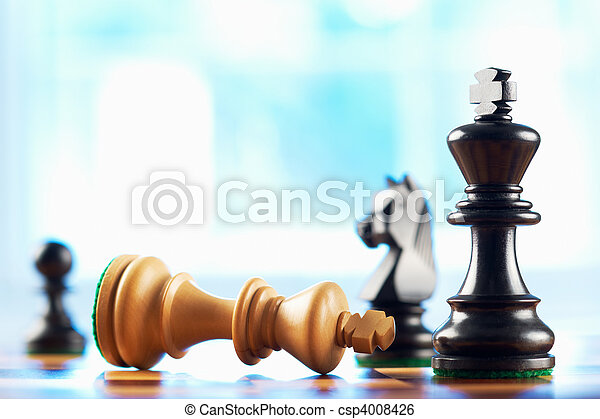 chess winner defeats white king - csp4008426