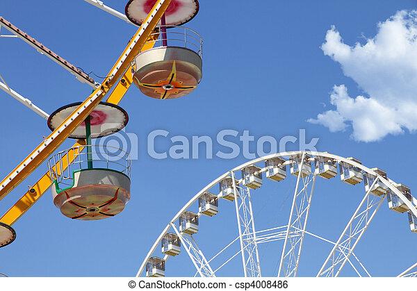 Ferris wheels in an amusement park - csp4008486