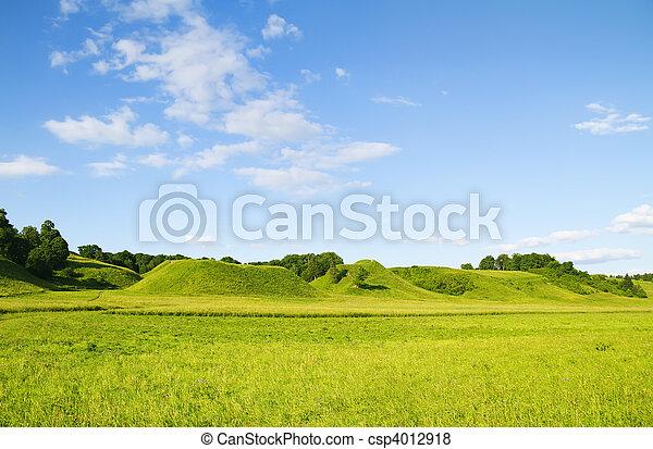 green hill blue cloudy sky - csp4012918