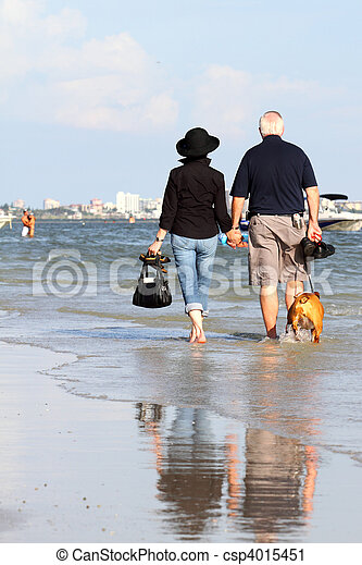 Happy elderly couple enjoying their retirement vacation - csp4015451