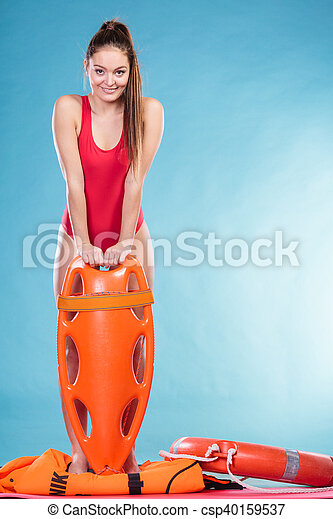 Lifeguard with rescue tube buoy. Woman supervising swimming pool water. Accident prevention and rescue.