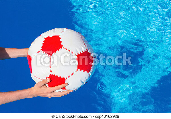 Stock Photo Of Arms Holding Beach Ball Above Swimming Pool Water