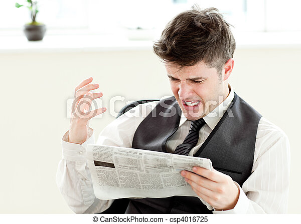 Portrait of a annoyed businessman reading a newspaper  - csp4016725