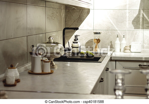 White dishes standing on the kitchen counter , ceramic tableware , kitchen sink