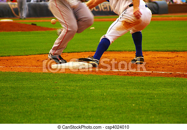baeball player running to first base ahead of the throw - csp4024010