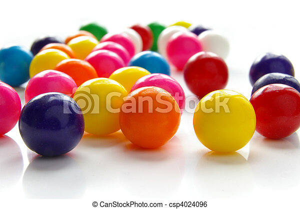 Assorted brightly colored candy gum balls on white - csp4024096
