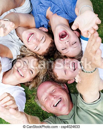 Multi-generation family lying in circle - csp4024633