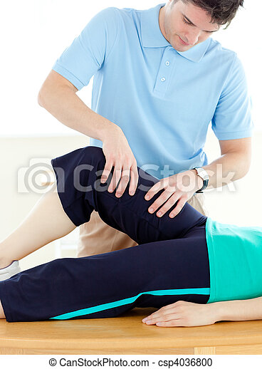 Young man doing fitness exercises with a patient - csp4036800