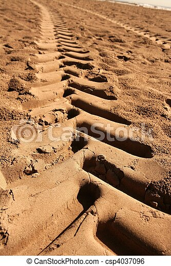 industrial tractor footprint on beach sand - csp4037096