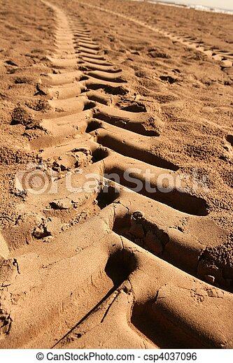industrial tractor footprint on beach sand - csp4037096