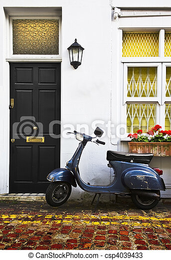 Scooter parking front of a typical apartment building in West Lond - csp4039433