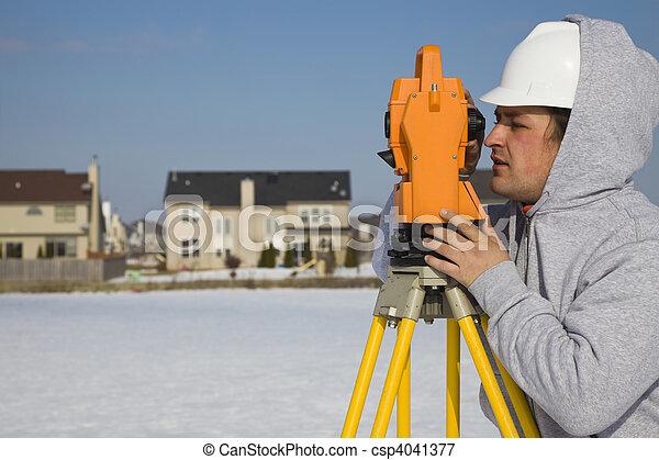 Land surveying during the winter - csp4041377