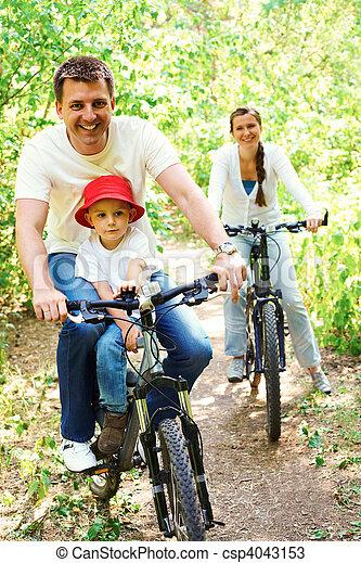 Riding bicycles - csp4043153