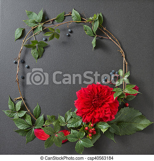 round frame of branches and flower and copycpase for text on black background