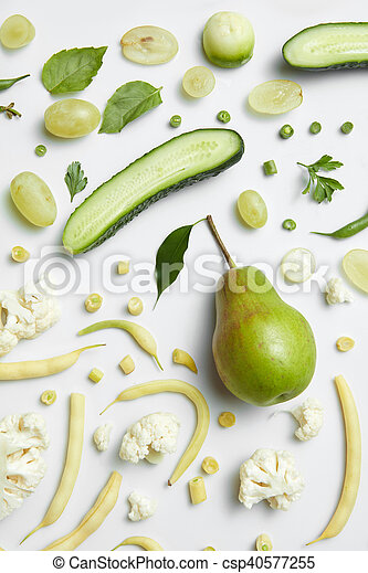 still life of fresh green vegetables and fruits