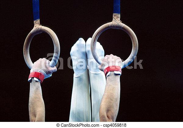 Men's gymnastics routine on the rings. - csp4059818