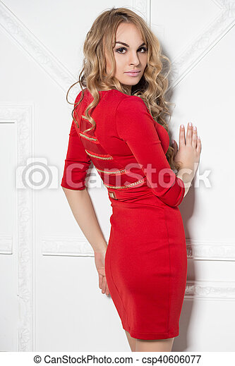 Attractive blonde in red dress - csp40606077
