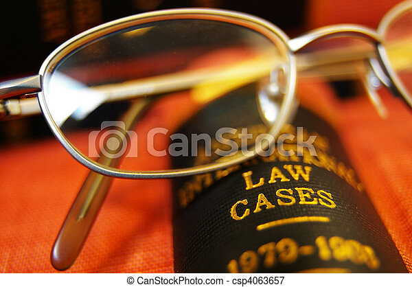 Closeup of open law book and glasses - csp4063657