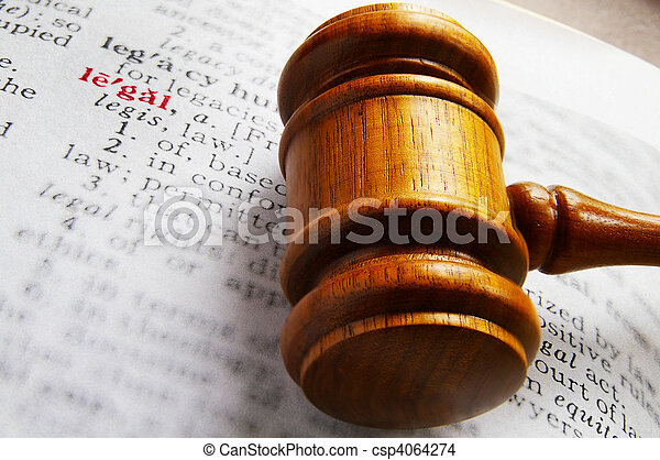 closeup of a gavel and dictionary legal definition - csp4064274