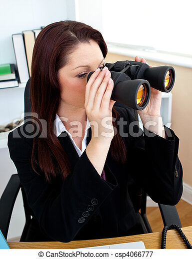 Concentrated businesswoman looking through spyglasses - csp4066777