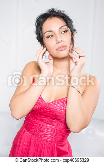 Portrait of pretty thoughtful brunette - csp40695329