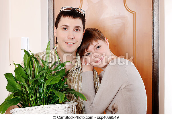 a charming young couple settlers went into their new apartment - csp4069549