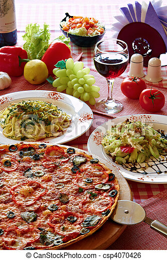 Classic Italian food setting with pizza, pasta, salad and wine - csp4070426