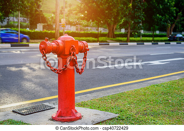 Red fire hydrant water pipe near the road. Fire hidrant for emergency fire access