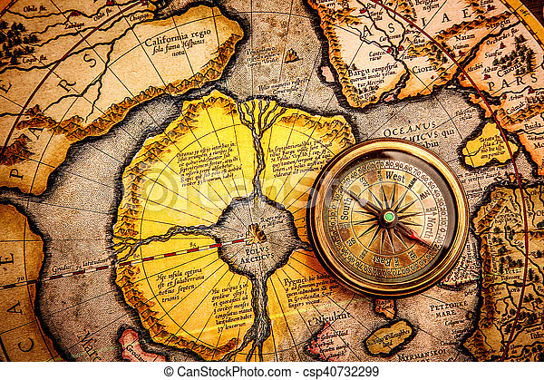 Vintage still life. Vintage compass lies on on the ancient map of the North Pole (also Hyperborea).. Arctic continent on the Gerardus Mercator map of 1595.