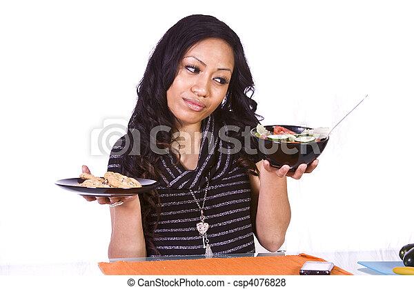 Beautiful Girl Deciding What to Eat - csp4076828