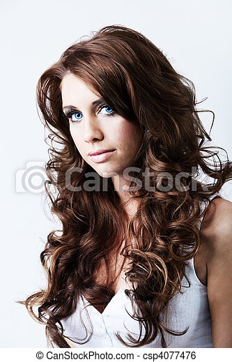 Portrait of woman with blue eyes and long curly hair - csp4077476