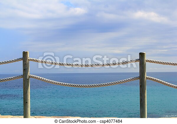 banister railing on marine rope and wood - csp4077484