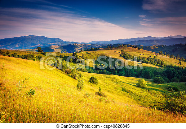 Fantastic green hills glowing by sunlight. Dramatic morning scenery. Carpathian, Ukraine, Europe. Beauty world.
