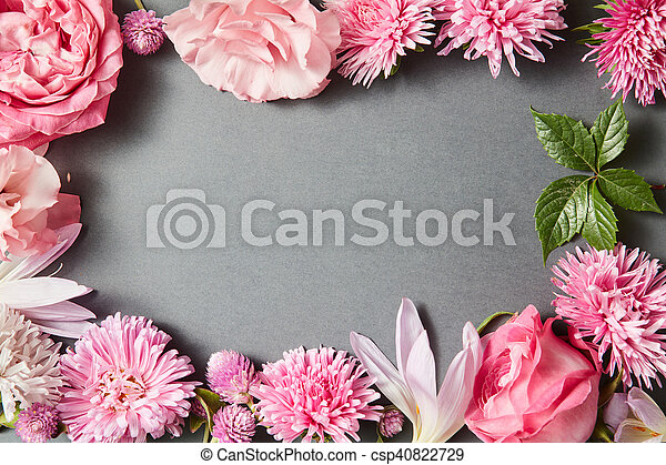 Beautiful pink flowers frame on black background