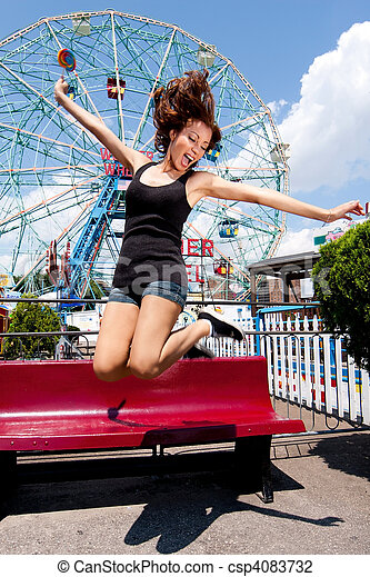Girl having fun in amusement park - csp4083732