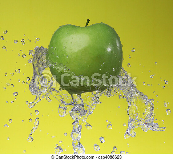 Green apple on yellow background