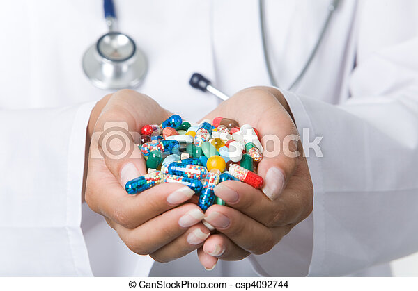 Handful of pills - csp4092744