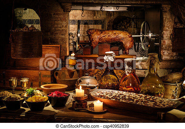 Medieval ancient kitchen tabe with typical food in royal castle.