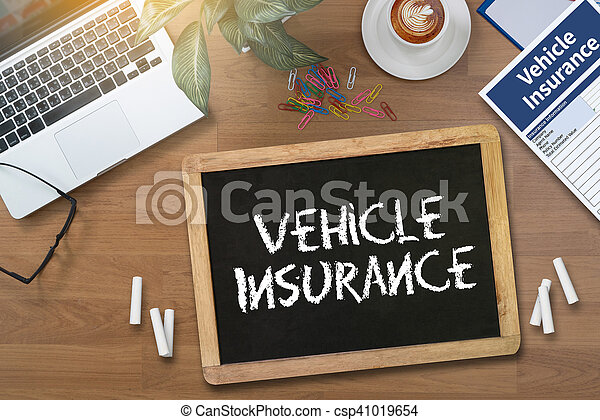Form Document Vehicle Insurance Claim digital tablet pc, computer and cup of coffee on wooden table, with copy space.